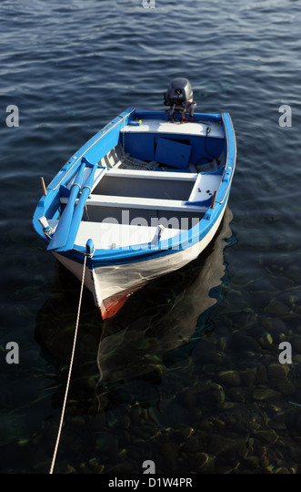 Alicudi, Italy, empty rowing boat in the water - Stock Image