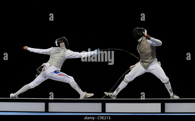 Marcel MARCILLOUX (FRA) [left] v Husayn ROSOWSKY (GBR) [right] during the men's foil competition at the London - Stock Image