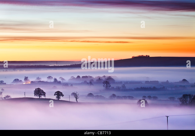 A winter sunrise view from Martinsell Hill over the Vale of Pewsey in Wiltshire, England, UK - Stock Image