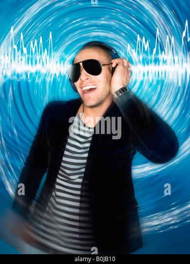 Man wearing headphones in front of circular effect, half-length - Stock-Bilder