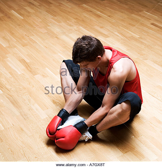 A young man wearing boxing gloves - Stock Image