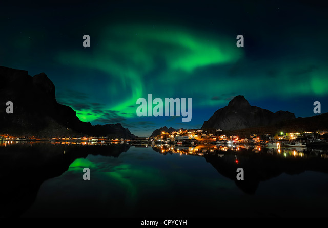 Norway, Nordland County, Lofoten Islands, Moskenes Island, aurora borealis over Reine fishermen village - Stock Image