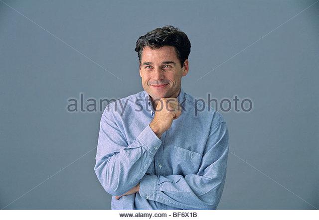 portrait of embarassed man - Stock Image