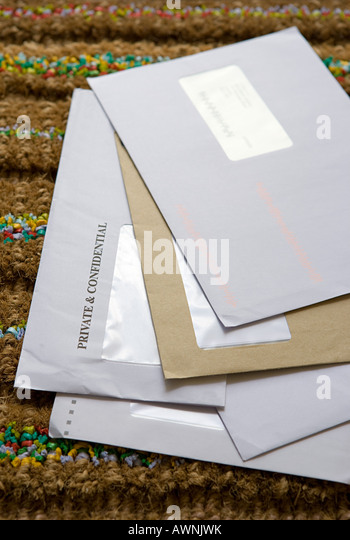 Mail on a doormat - Stock Image