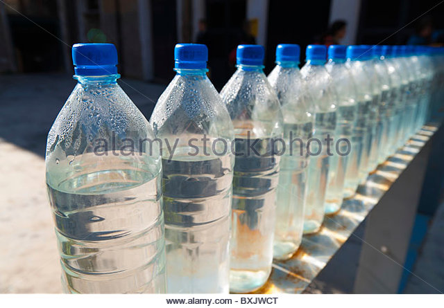 Bottles of water in a row - Stock Image