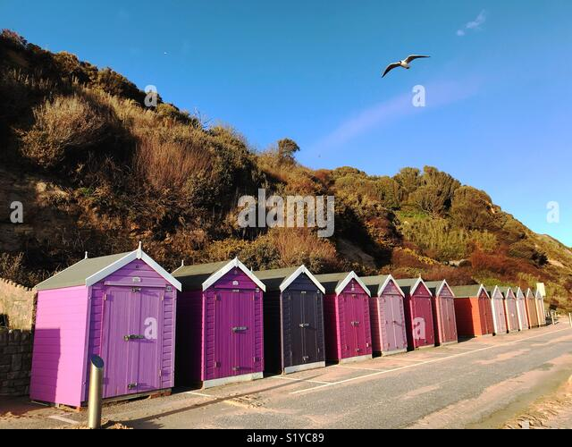 Colourful beach huts in Bournemouth - Stock Image
