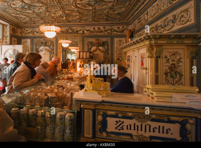 DEU Dresden Pfundsmolkerei mild and cheese shop in historical room with hand painted Majolika titles - Stock Image