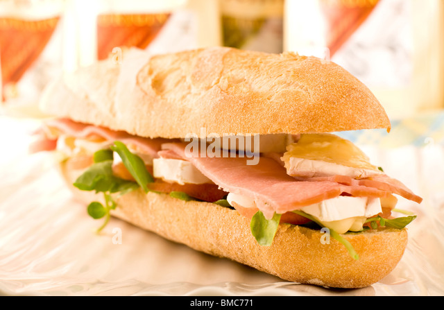 Sandwich with ham, tomato, and camembert Cheese - Stock Image