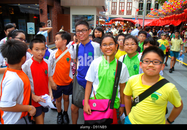 Singapore Chinatown Asian boy girl student class trip - Stock Image