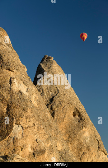 Fairy chimneys and hot air balloon, near Goreme, Cappadocia, Turkey - Stock Image