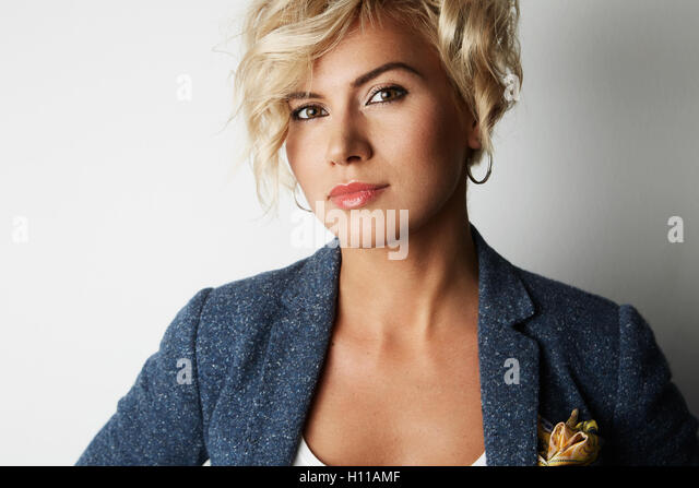 Portrait Handsome Young Woman Blonde Hair Wearing Blue Jacket Empty White Background.Beauty Fashion People Photo.Pretty - Stock Image