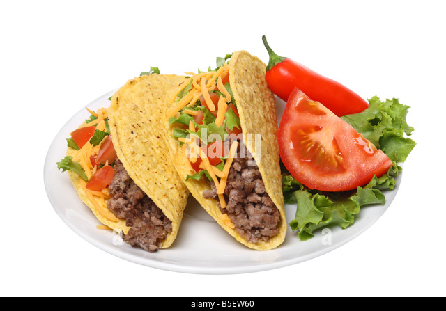 Plate with tacos cutout on white background - Stock Image