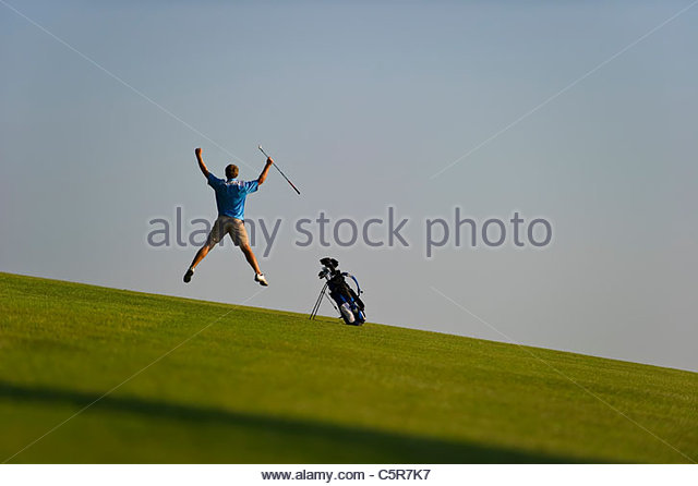 A golfer celebrates. - Stock-Bilder
