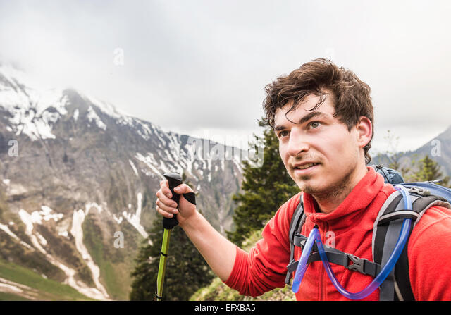 Portrait of young male hiker, Oberstdorf, Bavaria, Germany - Stock Image