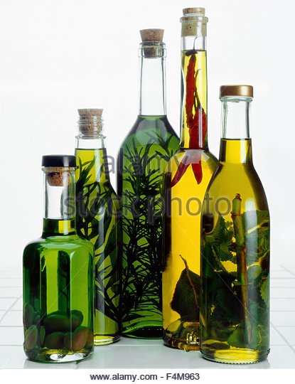 Still of extra virgin olive oils and herbal oils - Stock Image