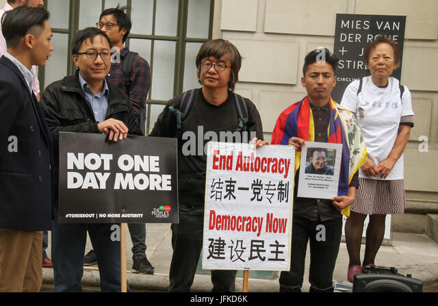 LONDON, UK - July 1, 2017: Shao Jiang (centre), eye witness of the​ ​Tienanmen Square with Umbrella movement supporters - Stock Image