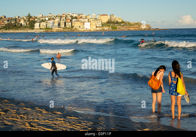 Sydney Australia NSW New South Wales Bondi Beach Pacific Ocean surf waves sand public North Bondi Rocks Asian woman - Stock Image