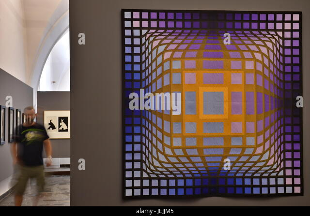 A visitor watches a painting by Hungarian born French artist Victor Vasarely at the exhibition in Ales South Bohemian - Stock-Bilder