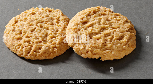 Two butter crunch oat cookie biscuits - Stock Image