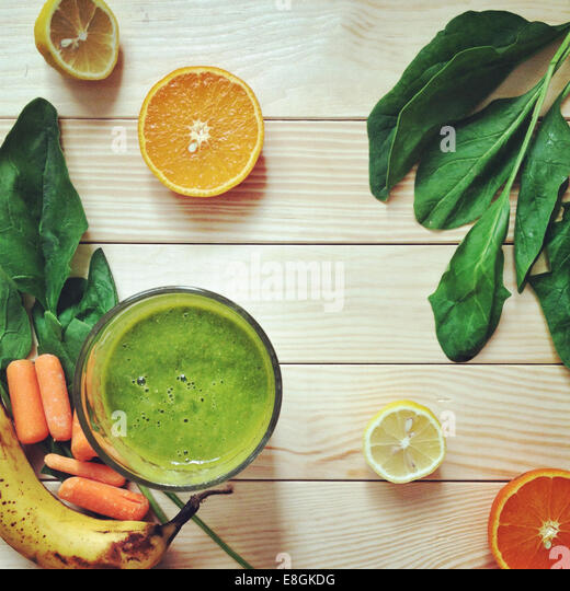 Green smoothie with fresh fruit and vegetables - Stock Image