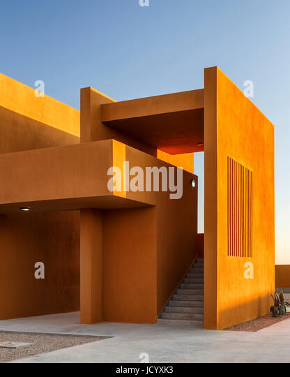 2-storey building with exterior stairway and venitlation slots. Laayoune Technology School, Laayoune, Morocco. Architect: - Stock-Bilder