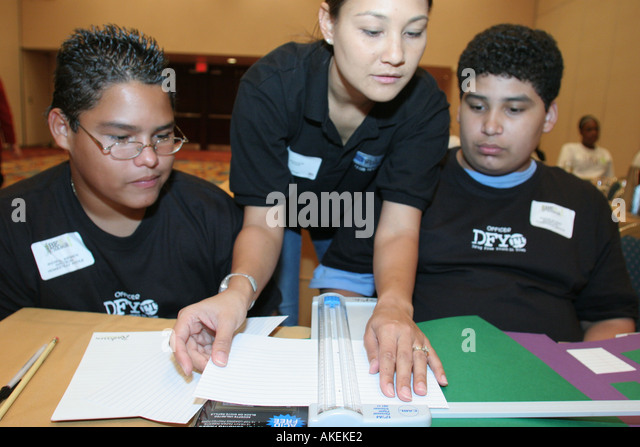 Miami Florida Radisson Hotel DFYIT Leadership Conference scrapbook session Asian female teacher - Stock Image