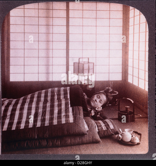 Young Woman Sleeping Between Futons, Stereo Photograph, 1904 - Stock Image