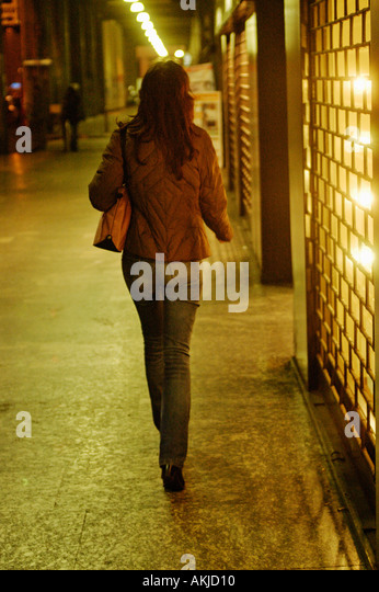 Italy, Milan, Lady walking down the street - Stock Image