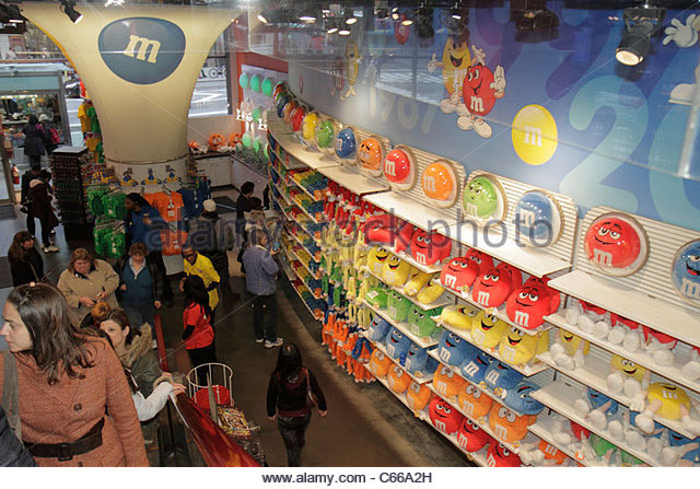 Manhattan New York City NYC NY Midtown Times Square M&M's World theme store business shopping shoppers display - Stock Image