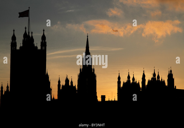 Houses of Parliament evening sunset silhouette London Thames Westminster - Stock Image