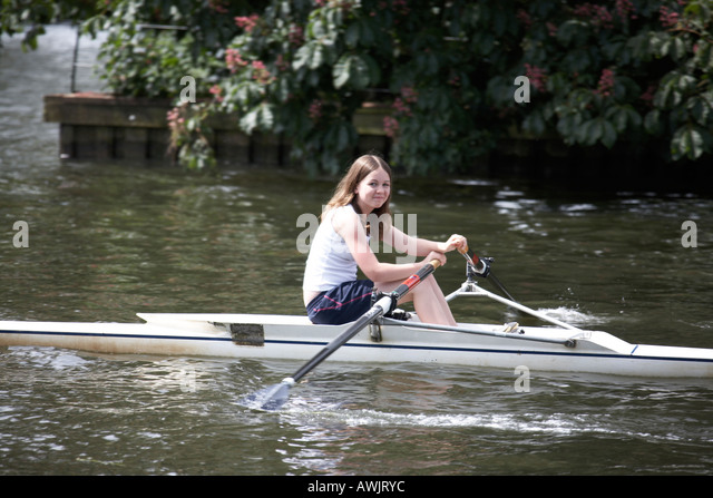 Girl on scull near Henley on Thames on River Thames between Buckinghamshire and Berkshire England UK - Stock Image