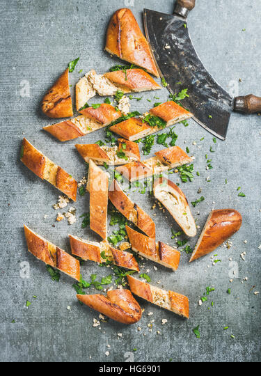 Slices of turkish pizza pide with cheese and spinach - Stock Image