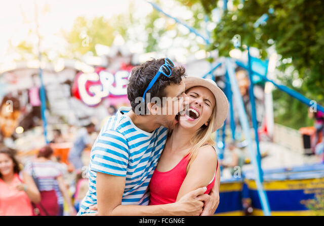 Happy couple at fun fair - Stock Image