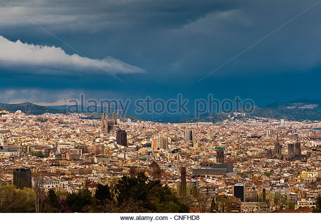 City skyline as seen from Montjuic with thunderstorm in the background, Barcelona, Catalonia, Spain - Stock Image