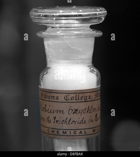 Glass bottle from a Victorian chemistry set containing a white chemical substance - Stock Image