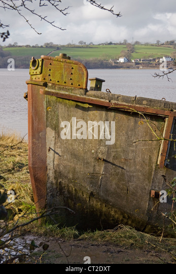 One of the old hulls beached on the banks of the River Severn at Purton in South Gloucestershire to prevent erosion - Stock Image