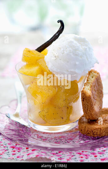 Vanilla-flavored pineapple with coconut ice cream - Stock Image