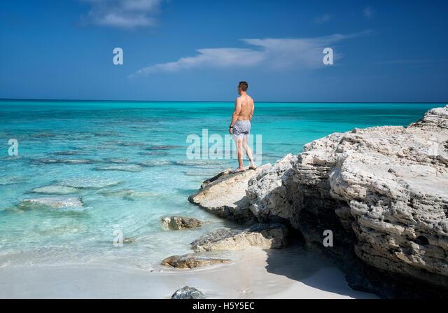 Visitor viewing ocean at Half Moon Bay. Turks and Caicos. Providenciales. - Stock Image