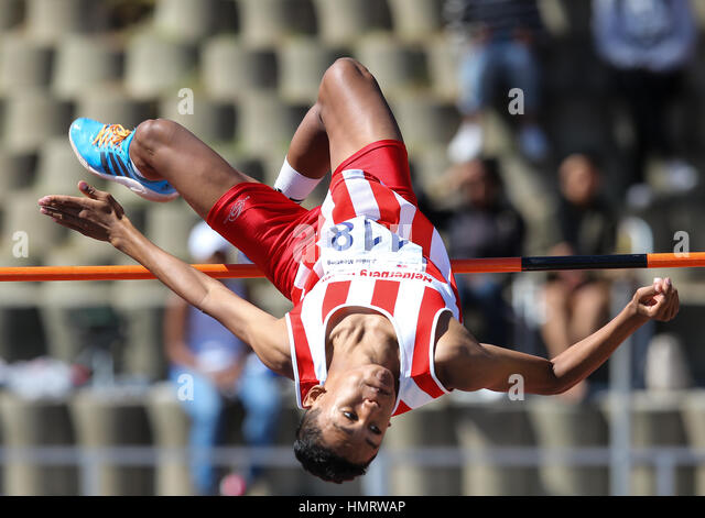 CAPE TOWN, SOUTH AFRICA - FEBRUARY 04: Breyton Poole (16) of Helderberg Harriers clears the bar at 2,14m in the - Stock-Bilder