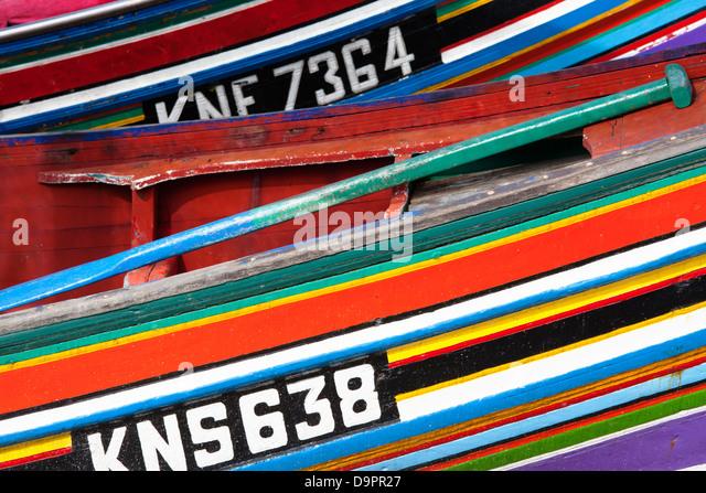 Colourfully decorated boats Sabak fish market, Kelantan, Malaysia - Stock Image