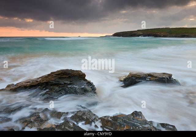 Incoming waves surge onto the sandy shore at Harlyn Bay in North Cornwall, England. Spring (May) 2010. - Stock Image