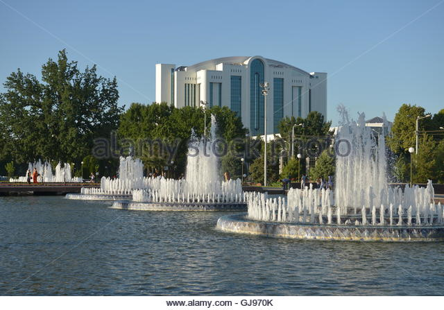 The large fountain in front of the main square in Tashkent. Square (Mustaqillik Maydoni) is the Central square of - Stock Image