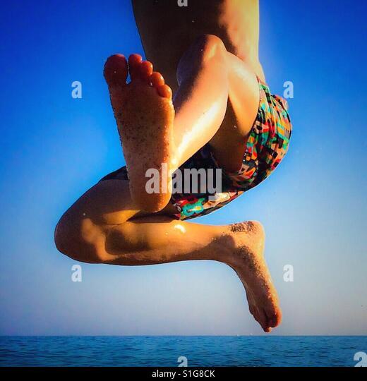 Boy jumping on the beach - Stock-Bilder