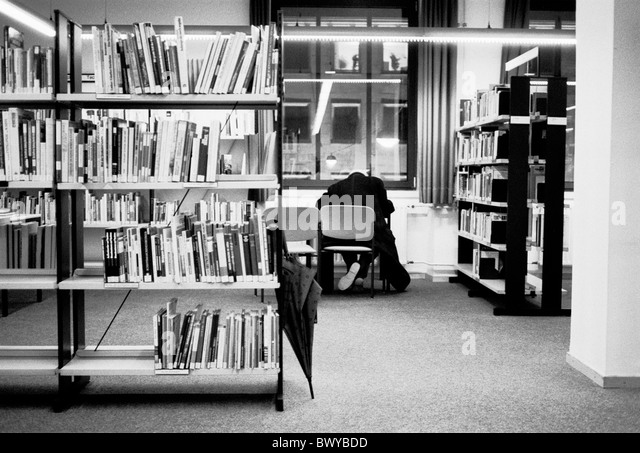 archive library books book shelves inside read literature man shelves umbrella black and white table des - Stock Image