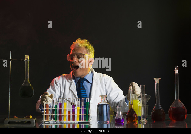 Scientist doing scientific experiment in a laboratory - Stock Image