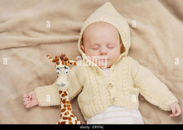 sleeping cute newborn baby, maternity concept, soft image of beautiful family - Stock-Bilder
