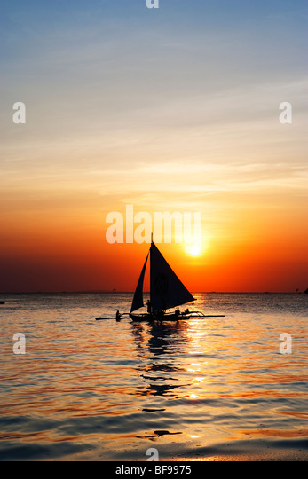 Sail boat at sunset Boracay; The Visayas; Philippines. - Stock Image