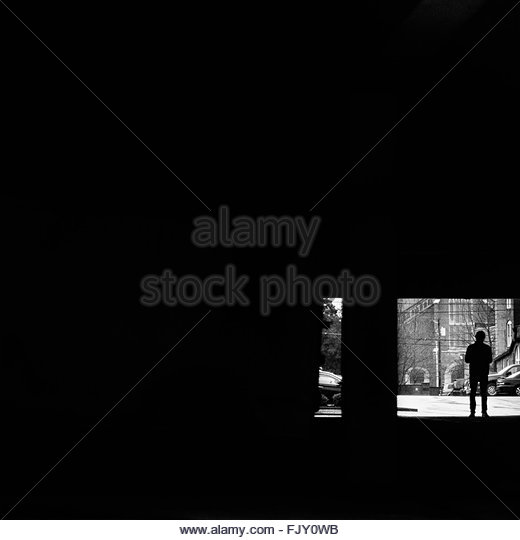 Rear View Of Silhouette Man Standing On Entrance - Stock-Bilder