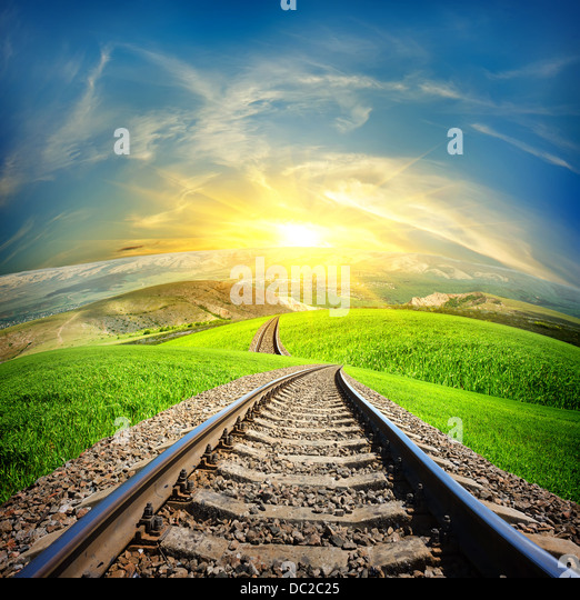 Railway in mountain fields in the sunlight - Stock Image