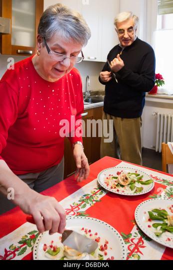Older couple having dinner together - Stock Image